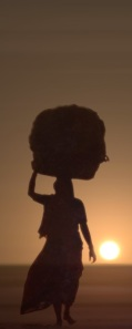 woman carrying load on her head-cropped