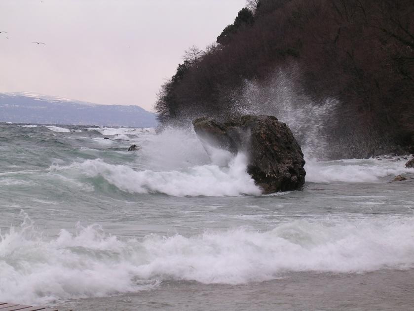 waves crash onto rock