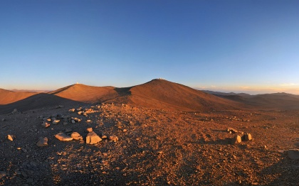 The otherworldly beauty of Chile's Atacama Desert, home of ESO's Very Large Telescope (VLT), stretches to the horizon in this panorama. On Cerro Paranal, the highest peak in the centre of this image, are the four giant Unit Telescopes of the VLT, each of which has a mirror with a diameter of 8.2 metres. On the peak to the left of Cerro Paranal is the VISTA survey telescope. This 4.1-metre telescope surveys broad swathes of the heavens, searching for interesting targets which the VLT, as well as other telescopes on the ground and in space, will study in greater detail. This region offers some of the best conditions for viewing the night sky found anywhere on our planet. On the right of this 360-degree panorama, the Sun is setting over the Pacific Ocean, throwing long shadows across the mountainscape. On the left, the Moon gleams in the sky. Soon, the night's observations will begin. This wonderful panorama was made by Serge Brunier, an ESO Photo Ambassador. It is one of many awe-inspiring images in which he captures ESO's observatories, their beautiful locations, and the splendour of the skies above them. Links  ESO Photo Ambassadors