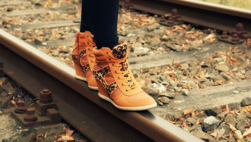 boots on railroad track