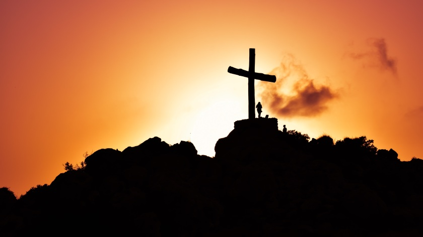 cross on hill + sunset/sunrise